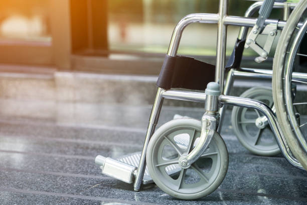 empty wheelchair parked in hospital - sedia a rotelle foto e immagini stock