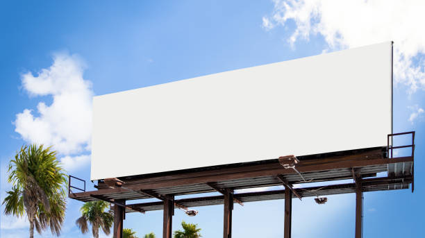 Empty white Billboard for presentation your design, Retail, advertising and commerce concept. Urban outdoor mockup. Perfect for the presentation of your creativity. These mockups are good to use for outdoor advertising! Only one easy step needed to use this mockups: just add or overlay your design and use anywhere. billboard stock pictures, royalty-free photos & images