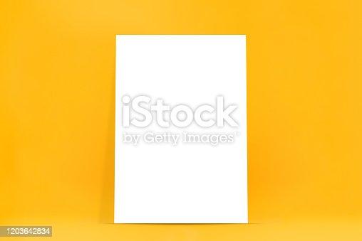 istock Empty white billboard on yellow bakground 1203642834