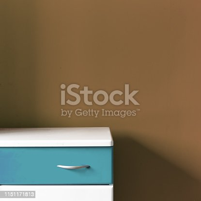 1151171813 istock photo Empty white blue stand at the soft brown wall in the room 1151171813