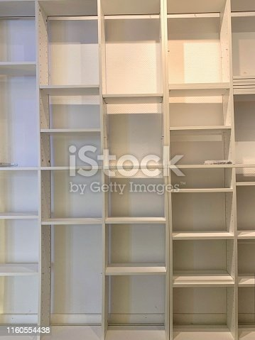 istock Empty white books shelves 1160554438