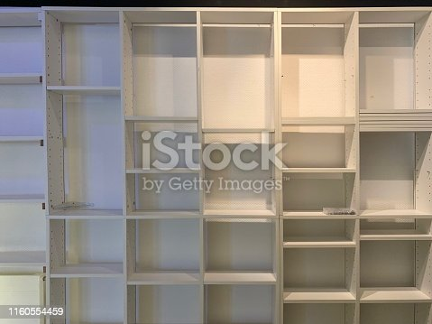 istock Empty white books shelves 1160554459
