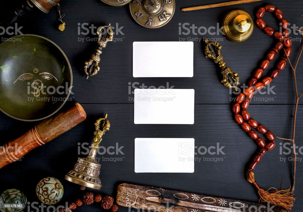 empty white business cards in the midst of Asian religious objects stock photo
