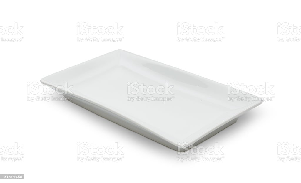 Empty white ceramic dish on white background stock photo