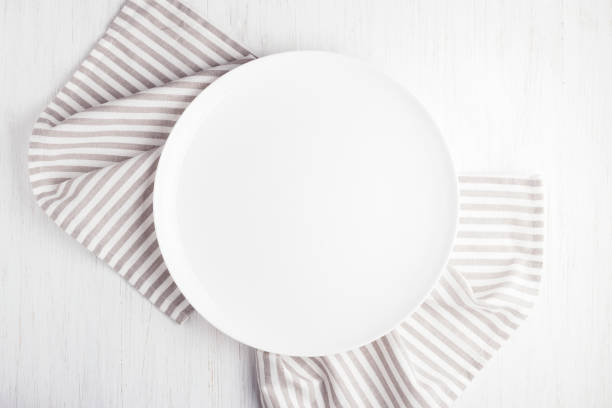 empty white circle plate on wooden table - plate stock pictures, royalty-free photos & images