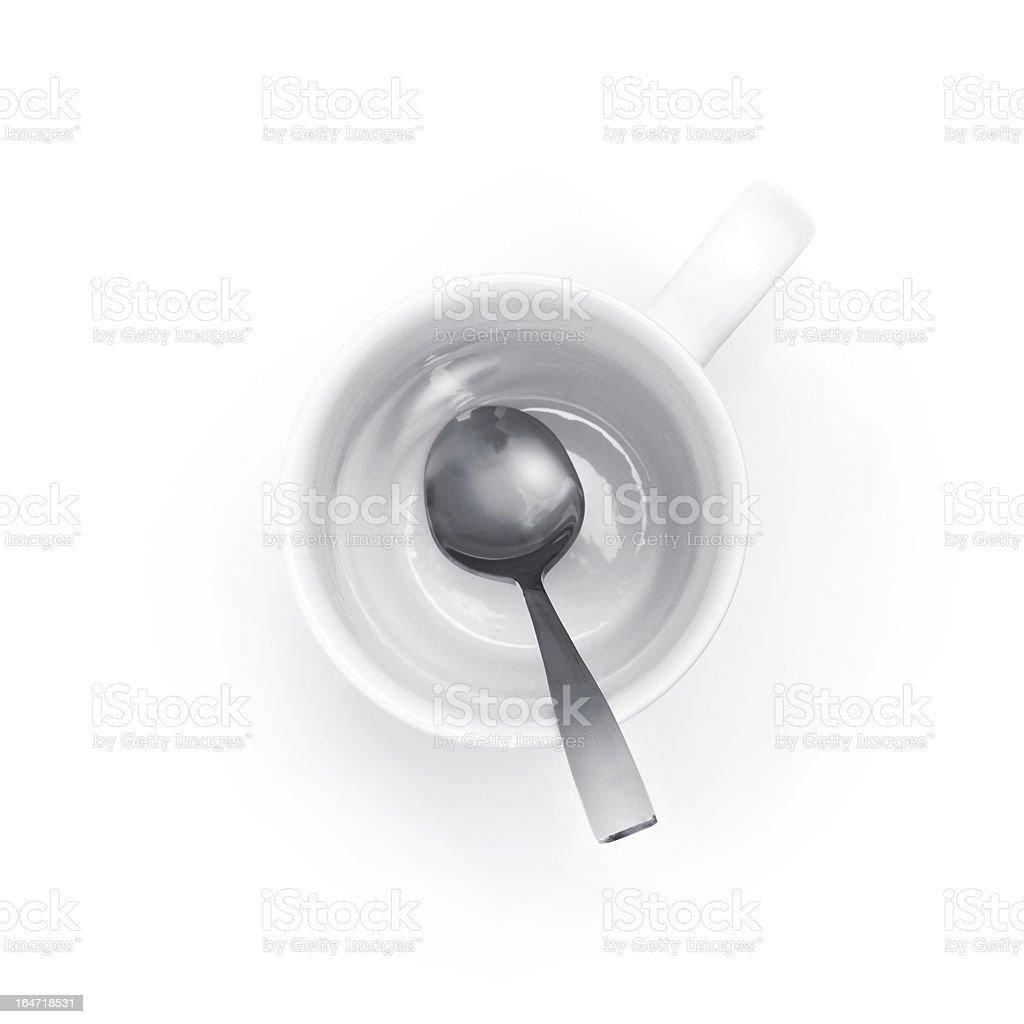 Empty white coffee cup with metal spoon top view royalty-free stock photo