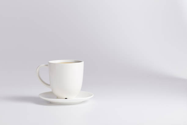 Cтоковое фото Empty white cup with sauser on white background