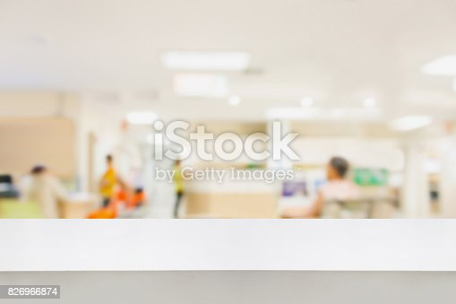 istock Empty white desk with blur hospital background 826966874