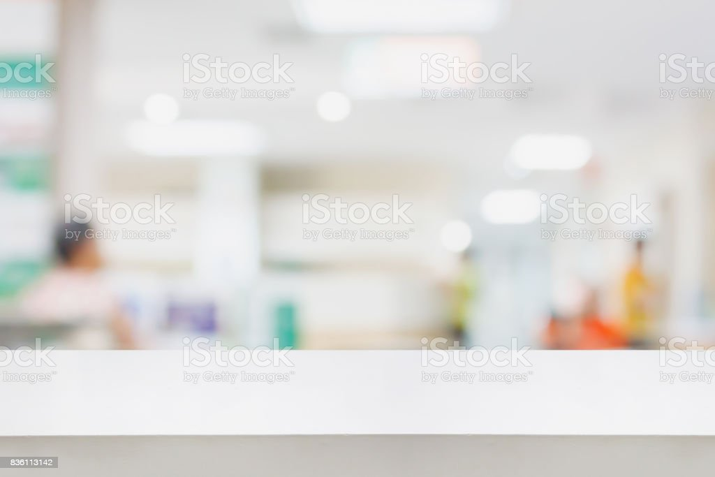 Empty white desk with blur hospital background stock photo