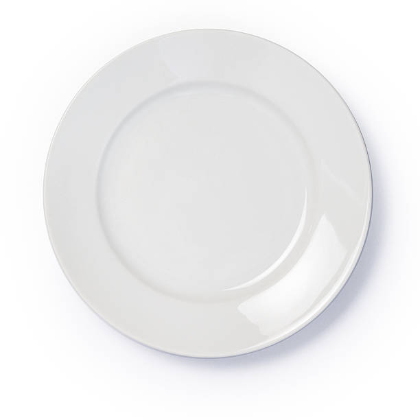 Empty white dinner plate on white background stock photo