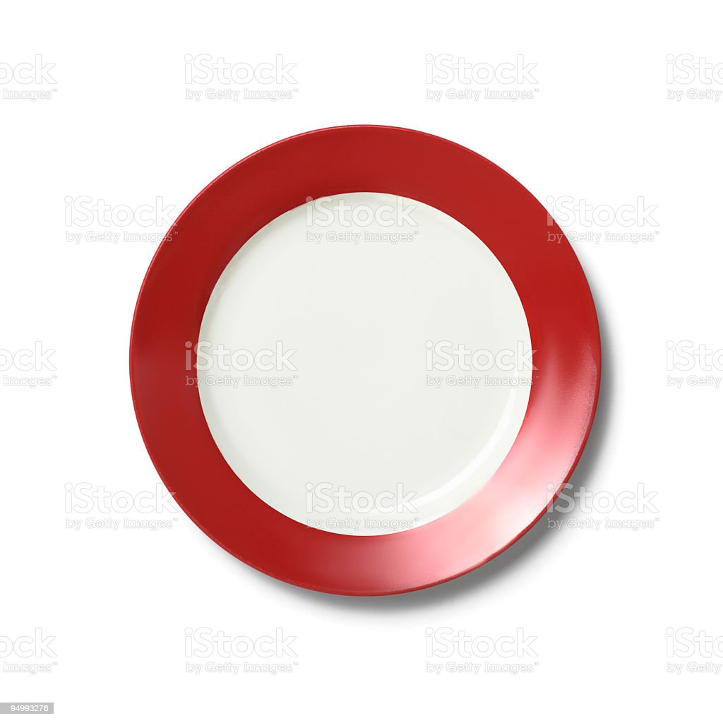 Empty white dinner plate with red rim on white background royalty-free stock photo