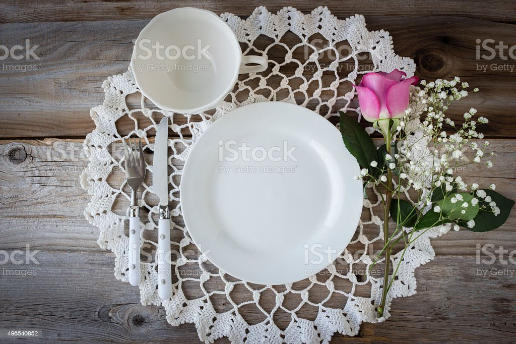 empty white glass plate and coffe cup with pink rose stock photo