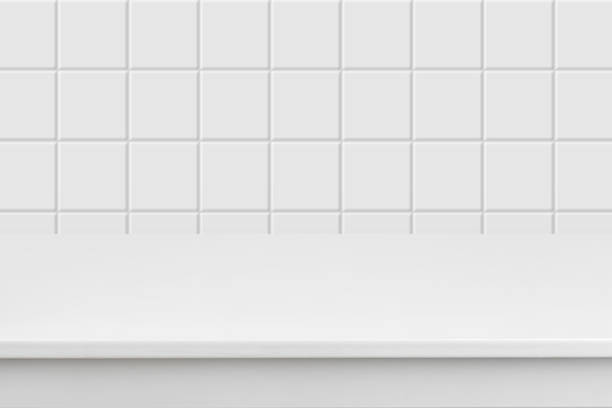Empty white laminated surface over blurred square ceramic tile wall stock photo