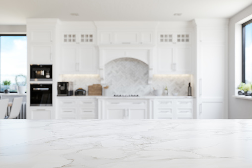 Empty white marble kitchen countertop with copyspace. Focus on foreground.