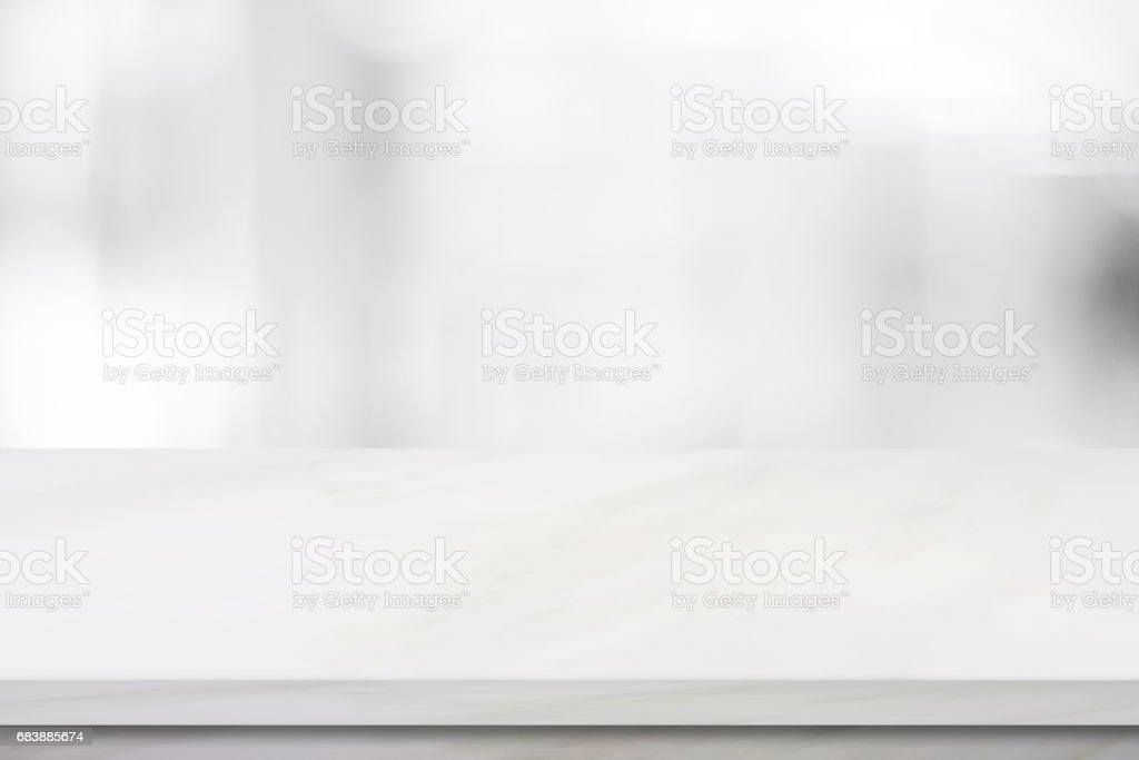Empty white marble over blur store background, product and food display montage stock photo