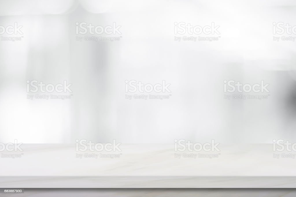 Empty white marble over blur store background, product and food display montage – Foto