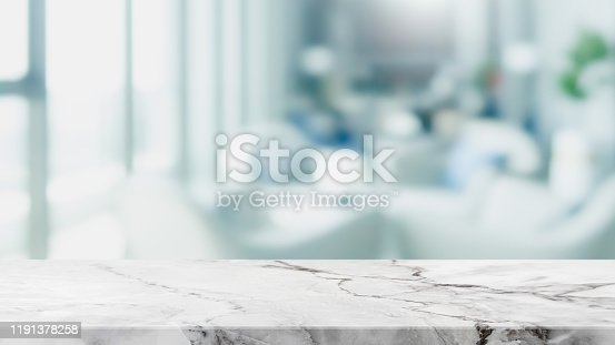 662984994 istock photo Empty white marble stone table top and blur glass window interior restaurant banner mock up abstract background - can used for display or montage your products. 1191378258