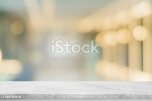 662984994 istock photo Empty white marble stone table top and blur glass window interior restaurant banner mock up abstract background - can used for display or montage your products. 1193192318