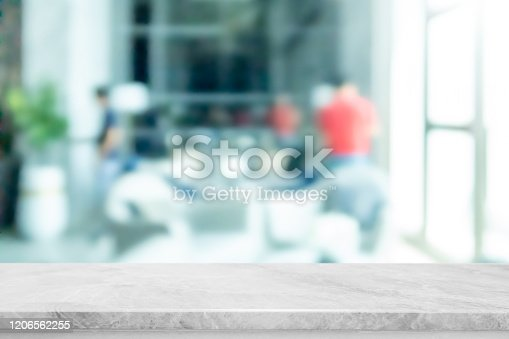 662984994 istock photo Empty white marble stone table top and blur glass window interior restaurant banner mock up abstract background - can used for display or montage your products. 1206562255