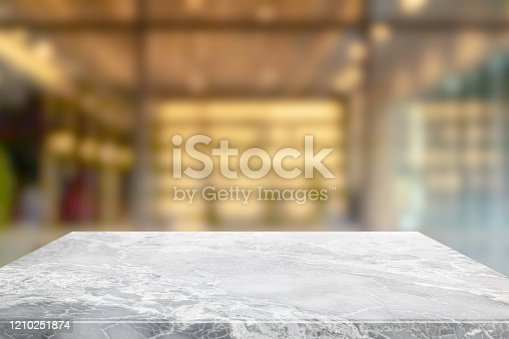 662984994 istock photo Empty white marble stone table top and blur glass window interior restaurant banner mock up abstract background - can used for display or montage your products. 1210251874
