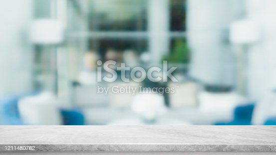 662984994 istock photo Empty white marble stone table top and blur glass window interior restaurant banner mock up abstract background - can used for display or montage your products. 1211480762