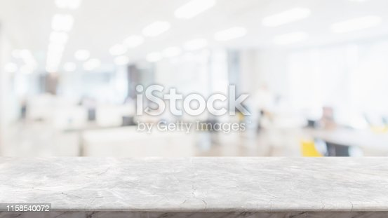 662984906istockphoto Empty white marble stone table top and blur glass window wall in office building space interior background - can used for display or montage your products. 1158540072