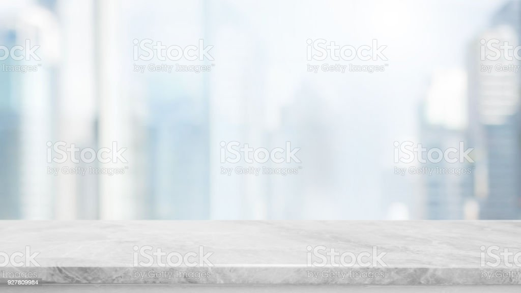 Empty White Marble Stone Table Top And Blur Glass Window Wall Building With  City View Background