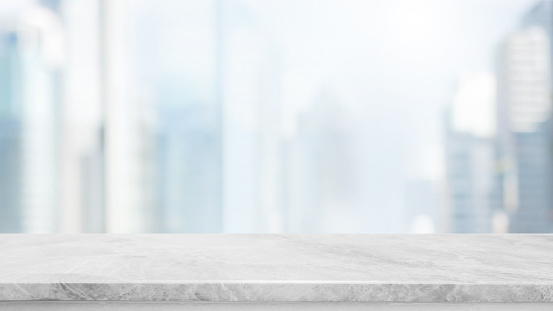 istock Empty white marble stone table top and blur glass window wall building with city view background - can used for display or montage your products. 927809984