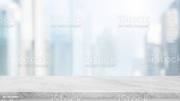Empty white marble stone table top and blur glass window wall with picture id927809984?b=1&k=6&m=927809984&s=612x612&h=m7graio2q7i0bp8exml63taukojlmslll0fdf7w6pmq=