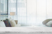 istock Empty white marble stone table top and blurred home interior with curtain window background. - can used for display or montage your products. 1193192310