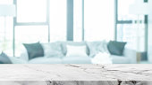 istock Empty white marble stone table top and blurred home interior with curtain window background. - can used for display or montage your products. 1205652336