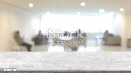 istock Empty white marble stone tabletop and blurred bokeh office interior space banner background - can used for display or montage your products. 1163687485