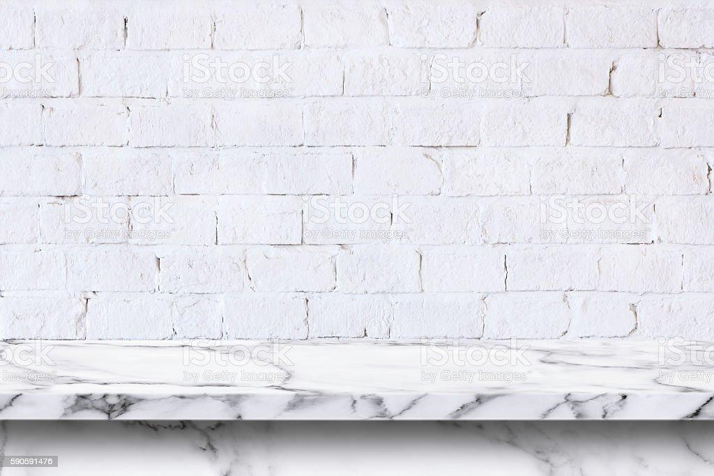 Empty white marble table on white brick wall background. stock photo
