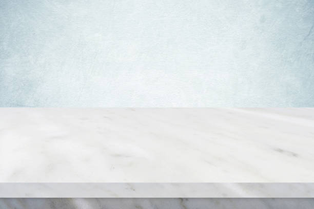 Empty white marble table over green cement wall background, banner, table top, shelf, counter design for product display montage Empty white marble table over green cement wall background, banner, table top, shelf, counter design for product display montage white marble stock pictures, royalty-free photos & images