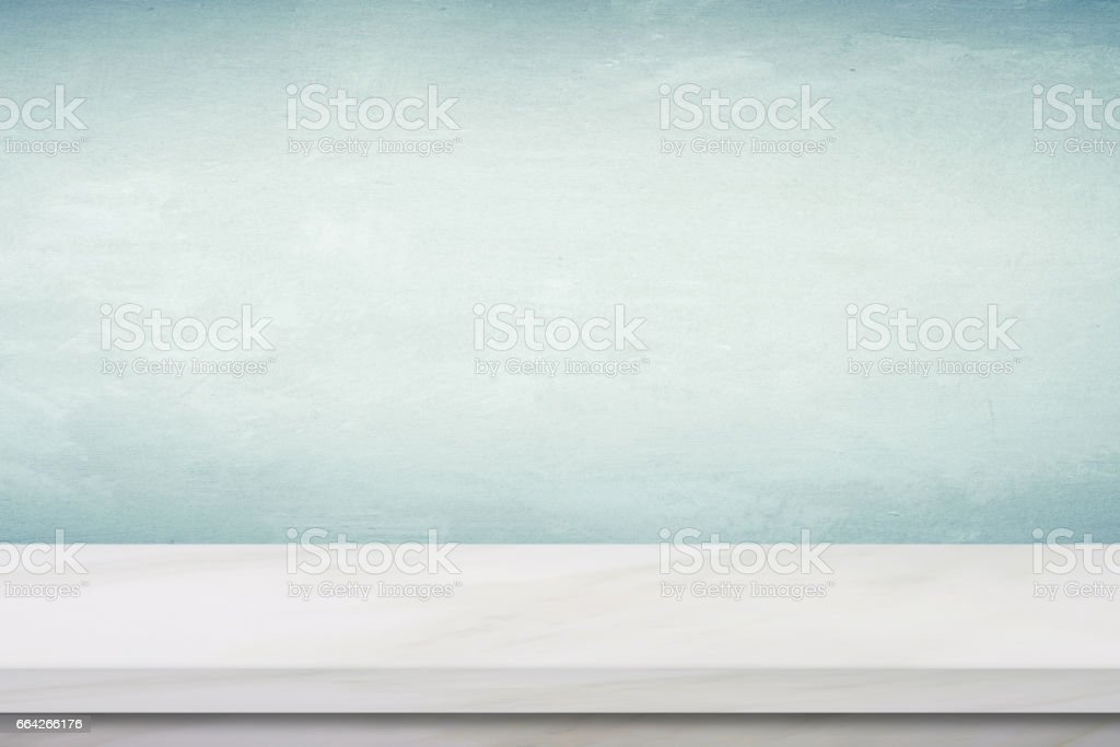 Empty white marble table over green cement wall background, product display montage stock photo