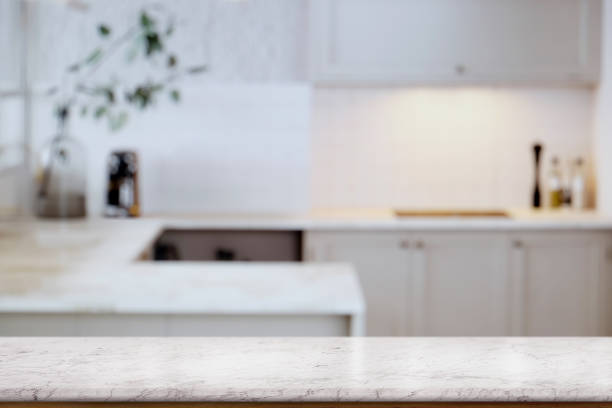 empty white marble  table top and  kitchen background. for food and product display montage - kitchen counter imagens e fotografias de stock