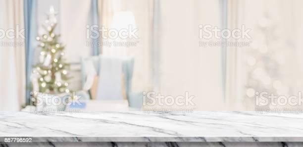 Empty white marble table top with abstract warm living room decor picture id887798592?b=1&k=6&m=887798592&s=612x612&h=nxy8hw07rnazz5b3tgorrc0q8u054yokkana8b5omwg=