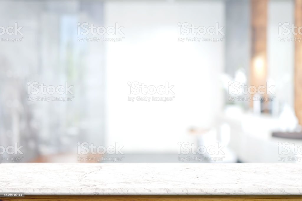 Empty white marble top table with blurred bathroom interior Background. for product display montage. - foto stock