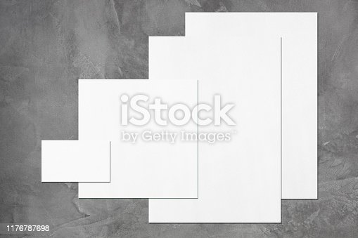 istock Empty white office stationery mockups on dark grey background 1176787698