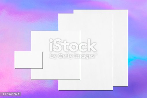 1139340462 istock photo Empty white office stationery mockups on holographic background 1176787492