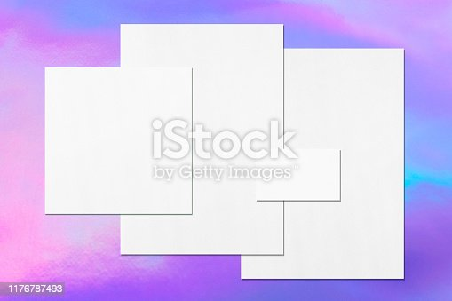 1139340462 istock photo Empty white office stationery mockups on holographic background 1176787493