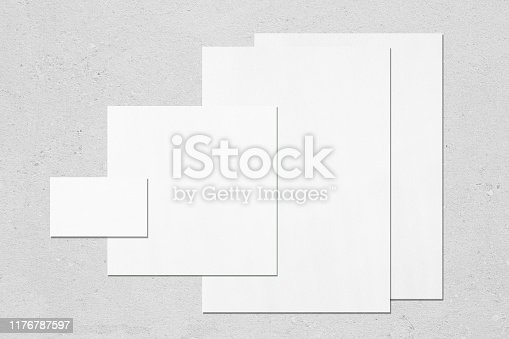 istock Empty white office stationery mockups on neutral light grey background 1176787597