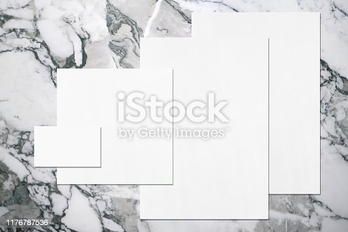 istock Empty white office stationery mockups with soft shadows on neutral grey marble background 1176787536