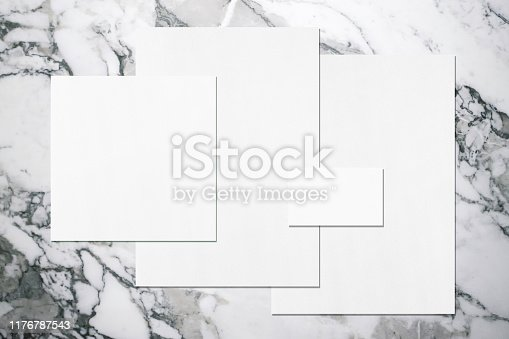 istock Empty white office stationery mockups with soft shadows on neutral grey marble background 1176787543