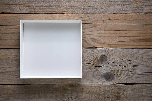 empty white open box on wooden background - puste pudełko zdjęcia i obrazy z banku zdjęć