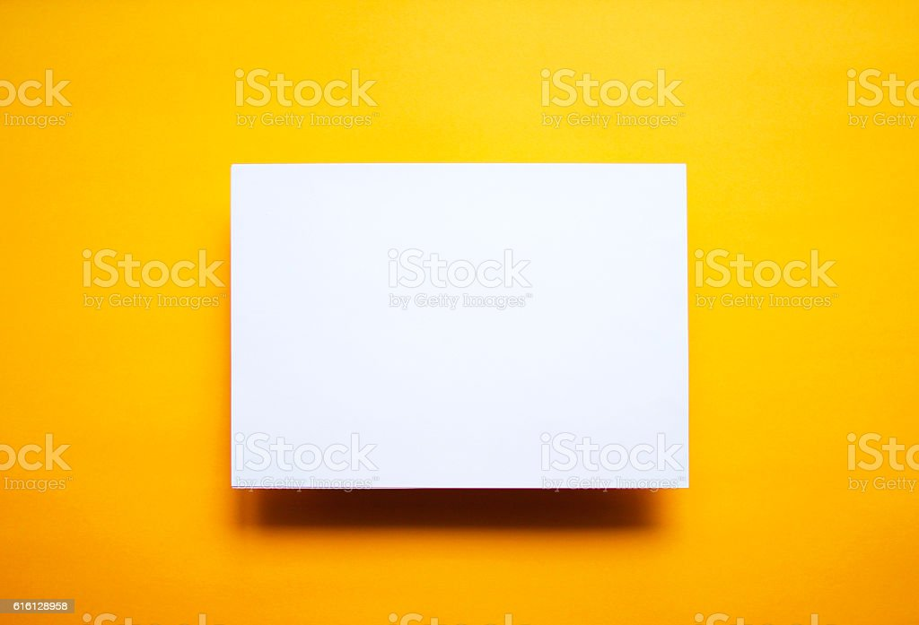 Empty white paper sheet isolated yellow background - Foto de stock de Amarillo - Color libre de derechos