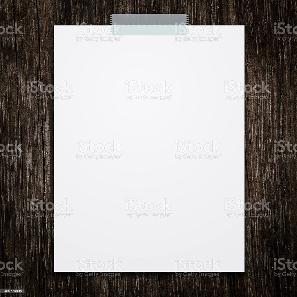 Empty white paper sheet stick on wood texture background. royalty-free stock photo