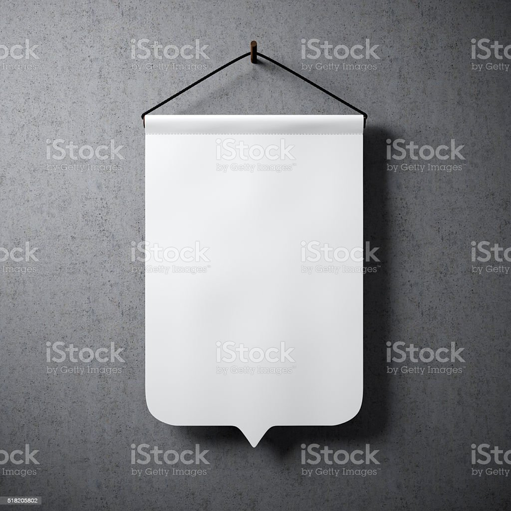 Empty white pennant hanging concrete wall. Ready for your business stock photo