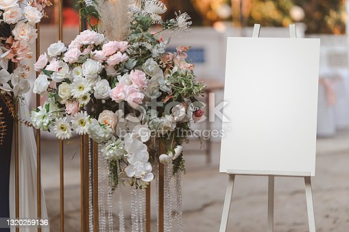 istock Empty white photo display board on stand for wedding arch. 1320259136