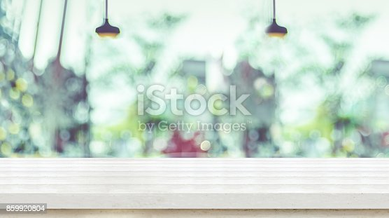 istock Empty White plank wooden table top with blurred window of coffee shop, Mock up template for display or montage of your design,Banner for advertise of product,panorama view 859920804